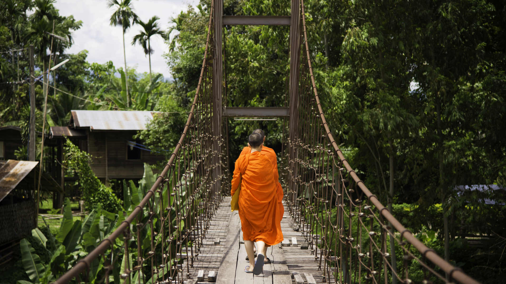 Buddhist Monks on the rope bridge Indochina