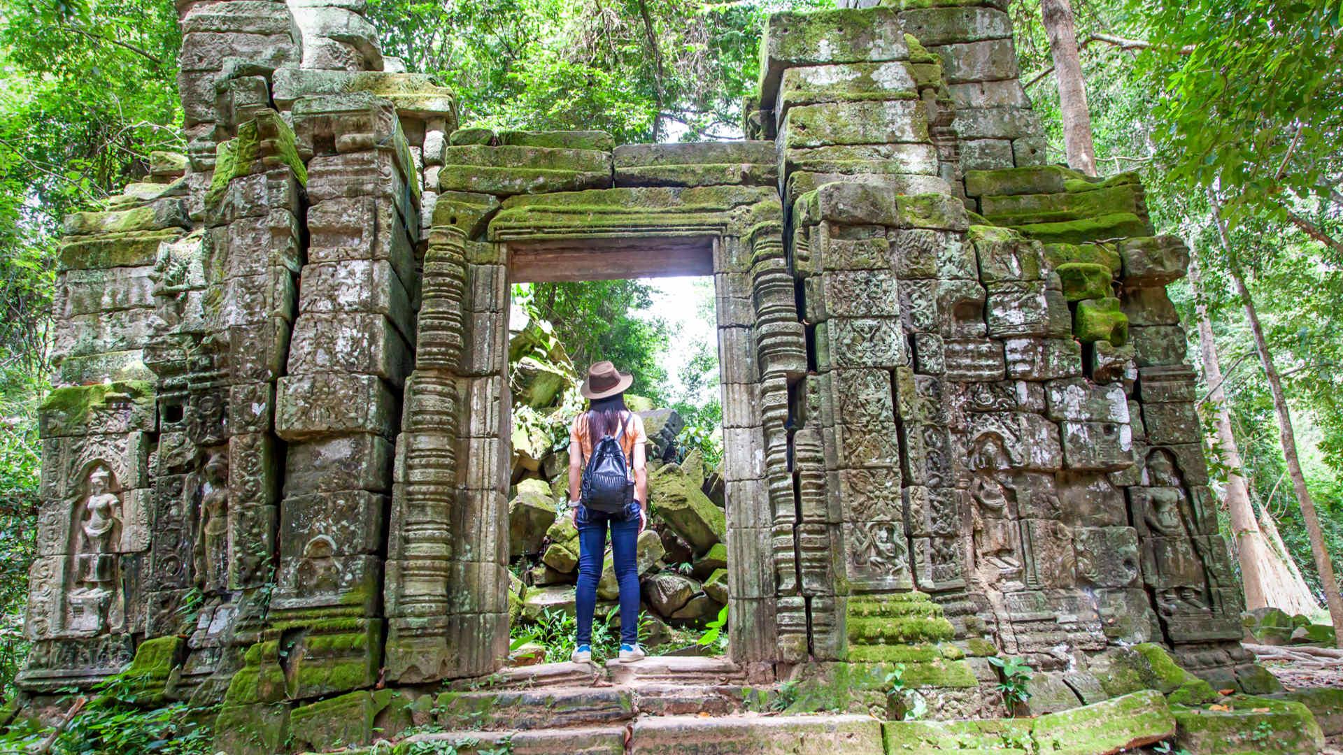 Tourist explors Angkor Wat Temple