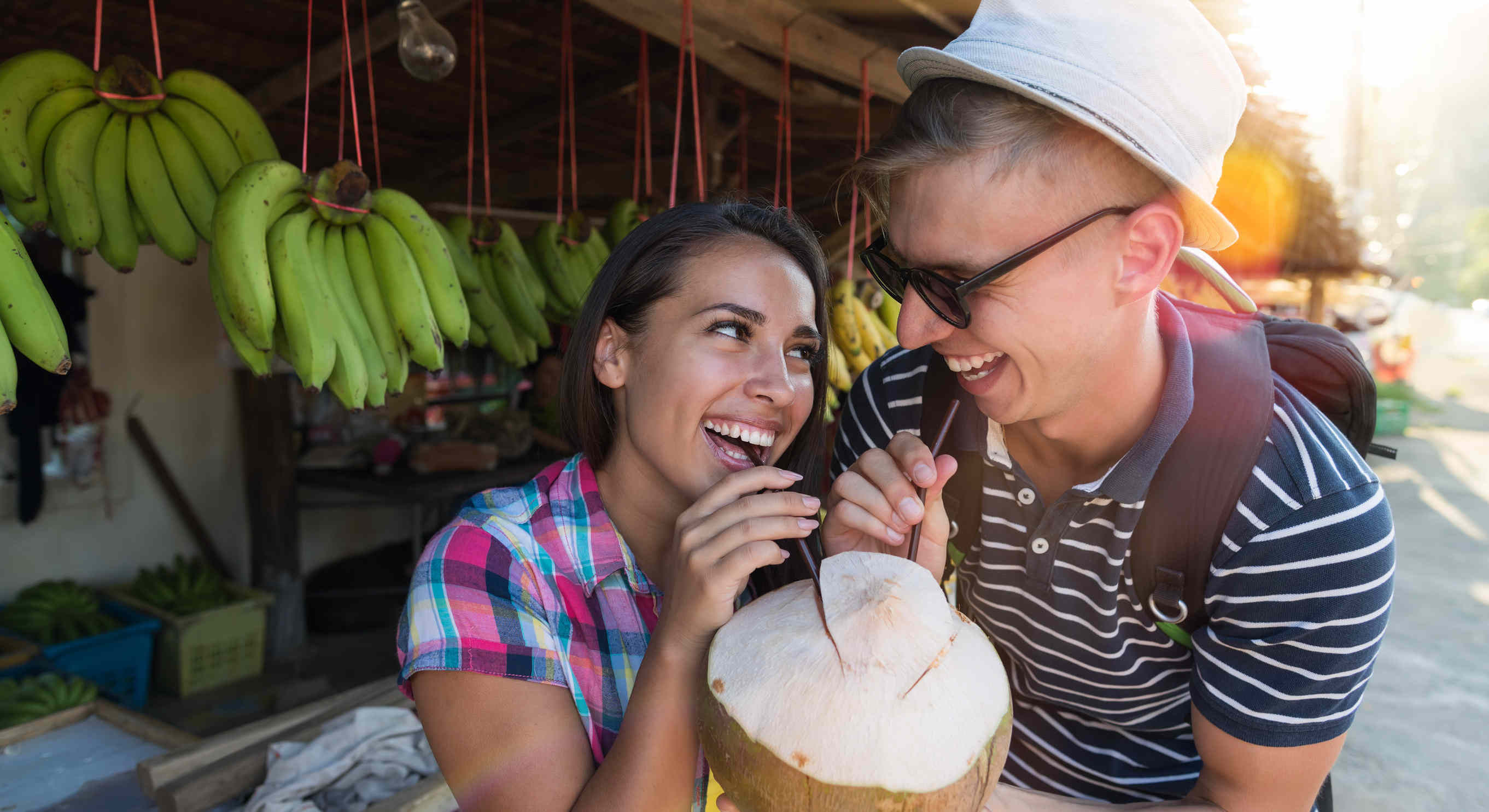 Happy Couple Drinking Coconut On Thailand Street Market