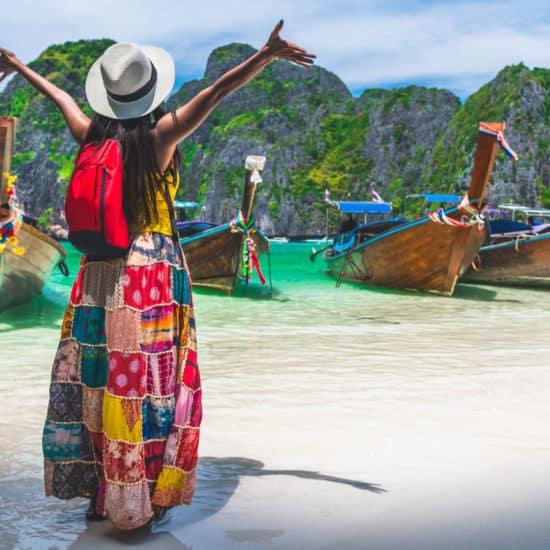 Tourist exploring Thailand island beach & boats