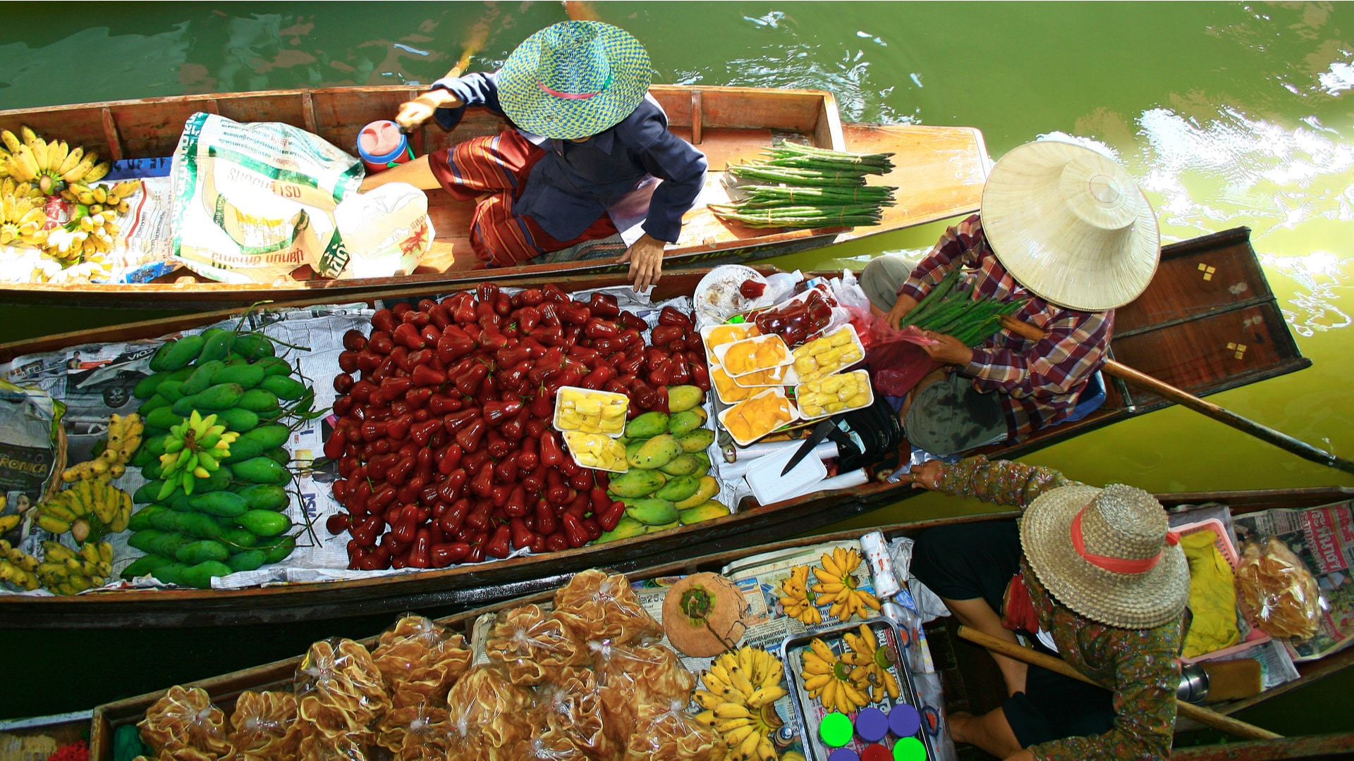 Thailand Bangkok floating market fruit vendors